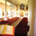 Church interior from Ambo perspective showing restored box pews and looking towards main entrance
