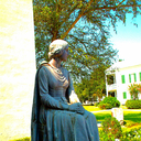 Historic statue of Longfellow's Evangeline near left/rear of Church.